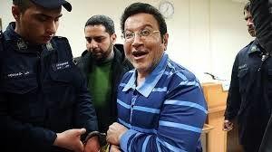 دیده شدن حسین هدایتی با ماسک در راهرو دادگاه کیفری