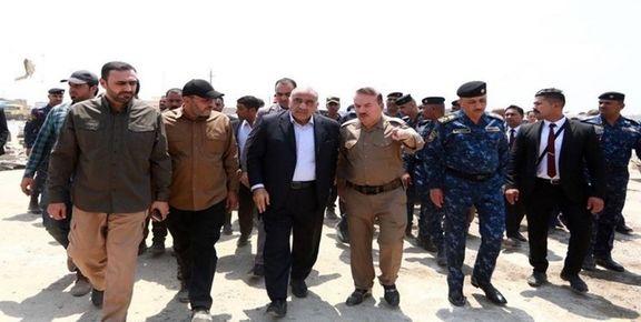 نخست وزیر عراق از محل انفجار انبار مهمات در جنوب عراق بازدید کرد